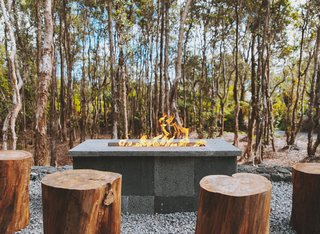Log seating around the fire pit reinforces Kūono's tie to nature.