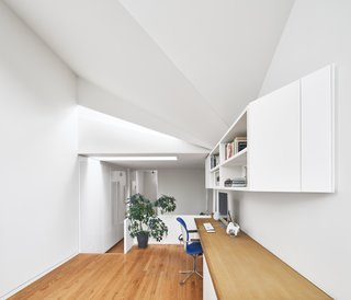 Upstairs, the light-refracting faceted ceiling is the design highlight.