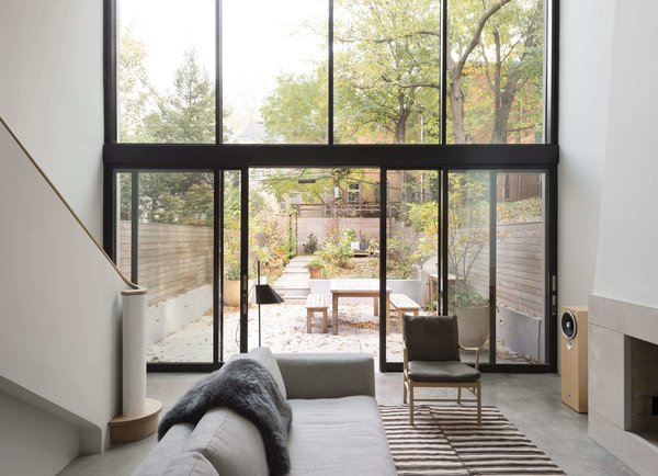 The townhouse's brilliant extension is defined by the garden, located just off the living room.
