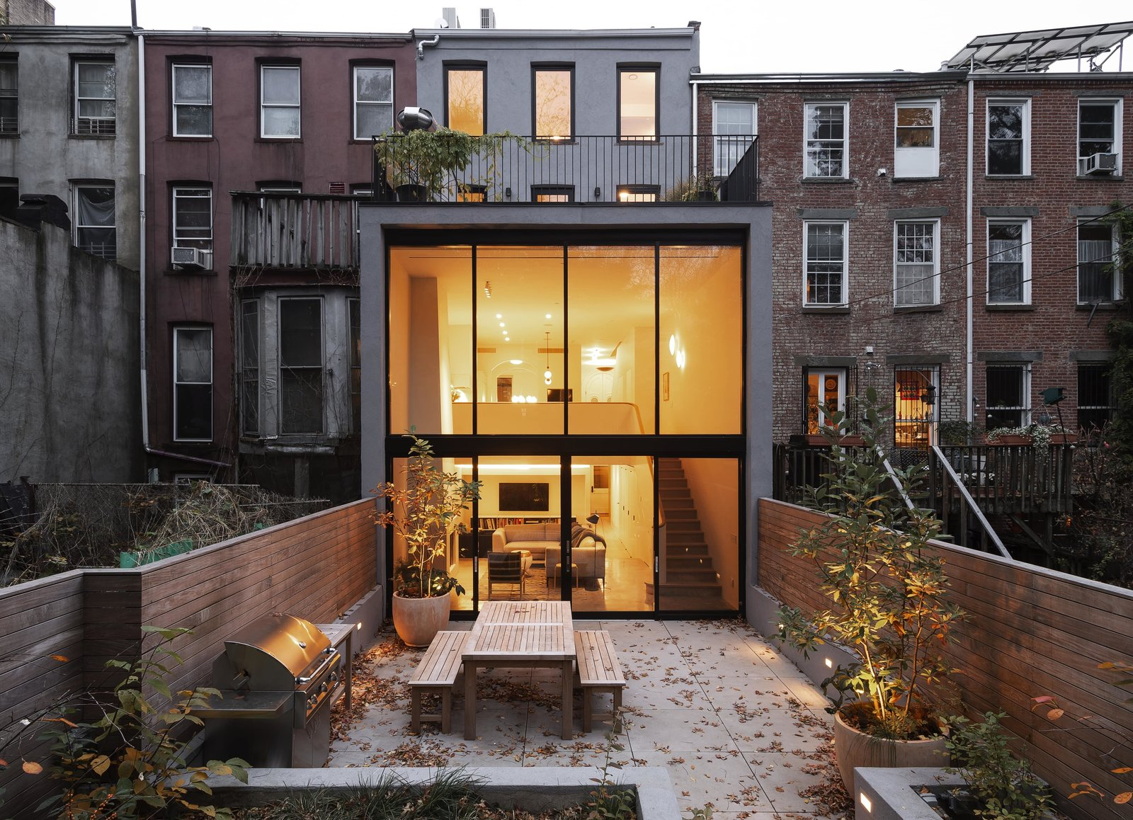 Exterior and House Building Type From the garden, an illuminated view into the bi-level extension.   Photo 1 of 13 in A Timeworn Brownstone in Brooklyn Becomes a Growing Family's Sanctuary