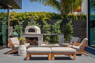 The homeowners are constantly entertaining, and the expansive patio is a prime gathering spot.