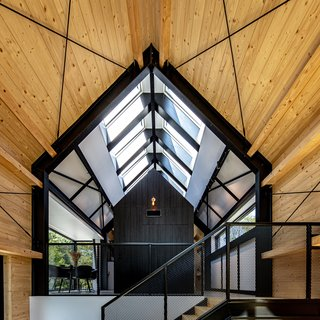 Natural light floods through the pitched roof's vast skylight.