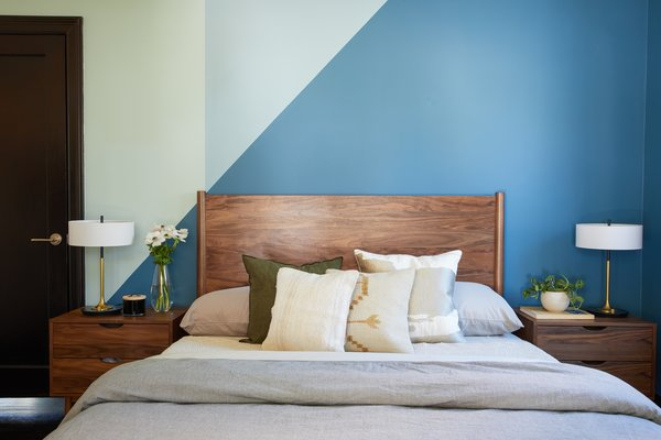 "Echoing the living room's color palette, the guest bedroom features a mix of Benjamin Moore ""Mozart Blue"" and ""Heavenly Blue."""
