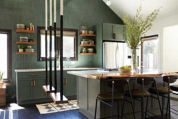 """I was a contrarian child and my favorite color was army green,"" recalls Gavankar. That early passion influenced the design of this kitchen, awash in Benjamin Moore ""Dakota Shadow."""