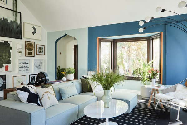 The living room's modern, midcentury-inspired furniture comes courtesy of Rove Concepts.