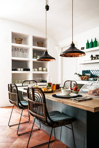 In the kitchen, a built-in open pantry is a storage-saving design feature.