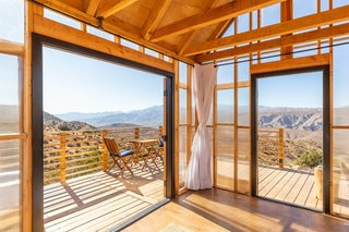 Large expanses of glass lead to the deck and panoramic desert views.