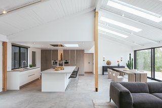 In the open-plan living area, one of the highlights is the natural light-filled kitchen from Italian manufacturer Armony.