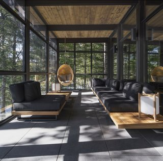 Wood on the ceiling and slate on the floor carries through to the veranda, forging another layer of dialogue between the indoors and outdoors.