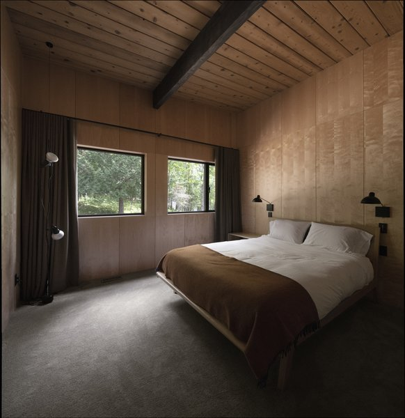 One of the serene bedrooms, where outdoor views are precisely framed.