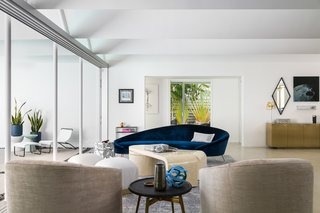 """This navy-blue velvet Ico Parisi–inspired Comma Sofa """"evokes a water element, soft movement, and speaks to the history of the home,"""" says Masters."""