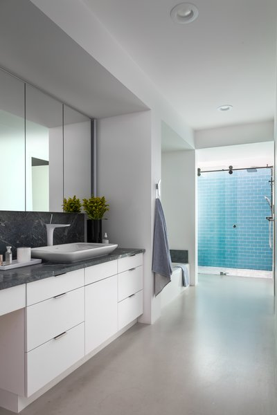 All of the bathrooms, which were sans doors in the previous iteration of the house, were reconfigured.