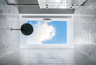 "The shower is crowned with ""an open hole through the sky when you look up,"" says Michael Epstein of Seibert Architects."