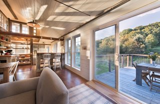 Beyond its sliding doors, this storybook barn in Gallatin is airy and filled with natural light, courtesy of old, quirky window sashes. Original wood from the vast, open structure—privacy awaits in the reading nook—has been re-imagined and bolstered by throw rugs and glamorous chandeliers. With views onto the pastoral meadow, alfresco grilling feasts around the deck's hand-made black locust table are bound to become a nightly occurrence.