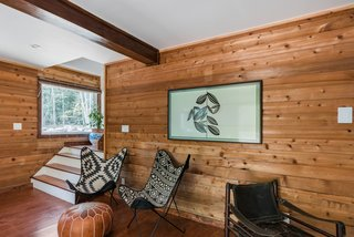 Minutes from the Windham Mountain resort (currently closed due to the COVID-19 pandemic), this wood-shrouded Maplecrest cabin has all the welcome trappings of a relaxing, rural weekend sanctuary: a grill for carefree barbecues, a front-porch swing, a quartet of Adirondack chairs gathered around a barrel table, and bunk beds that conjure childhood campgrounds. There's also a brand-new kitchen with gleaming tiles to whip up meals that can be served in the dining room, accentuated by a pouf and black-and-white patterned seating.