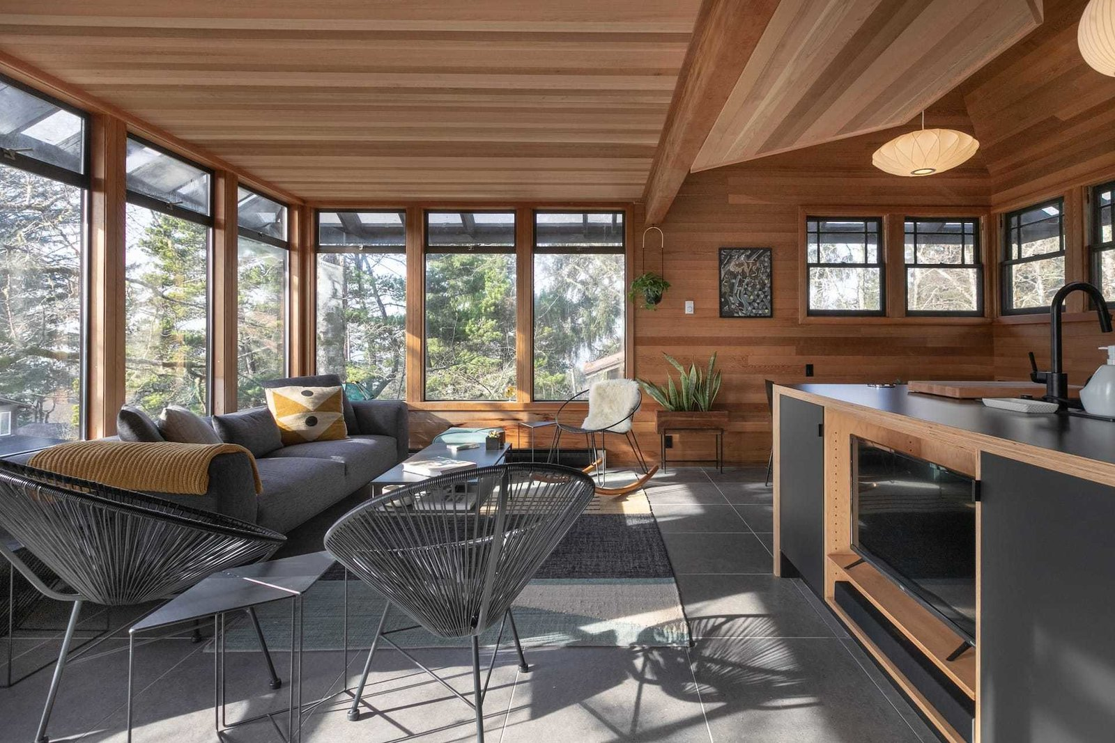 There are treehouse vibes galore in this wood-clad, three-story midcentury house—the entrance is reached by way of an elevated deck, for instance—propped on a hill above the sandy beach-strewn Manzanita. The hosts are designers, and so the interior is inviting and airy, with hues of gray and yellow playing with the abundance of natural light. It may feel secluded here, but Neahkahnie Beach, a more subdued alternative to kayaking at nearby Nehalem Bay State Park, is only a five-minute stroll away.  Photo 3 of 18 in 17 Dreamy and Rentable Retreats for a Pacific Northwest Escape