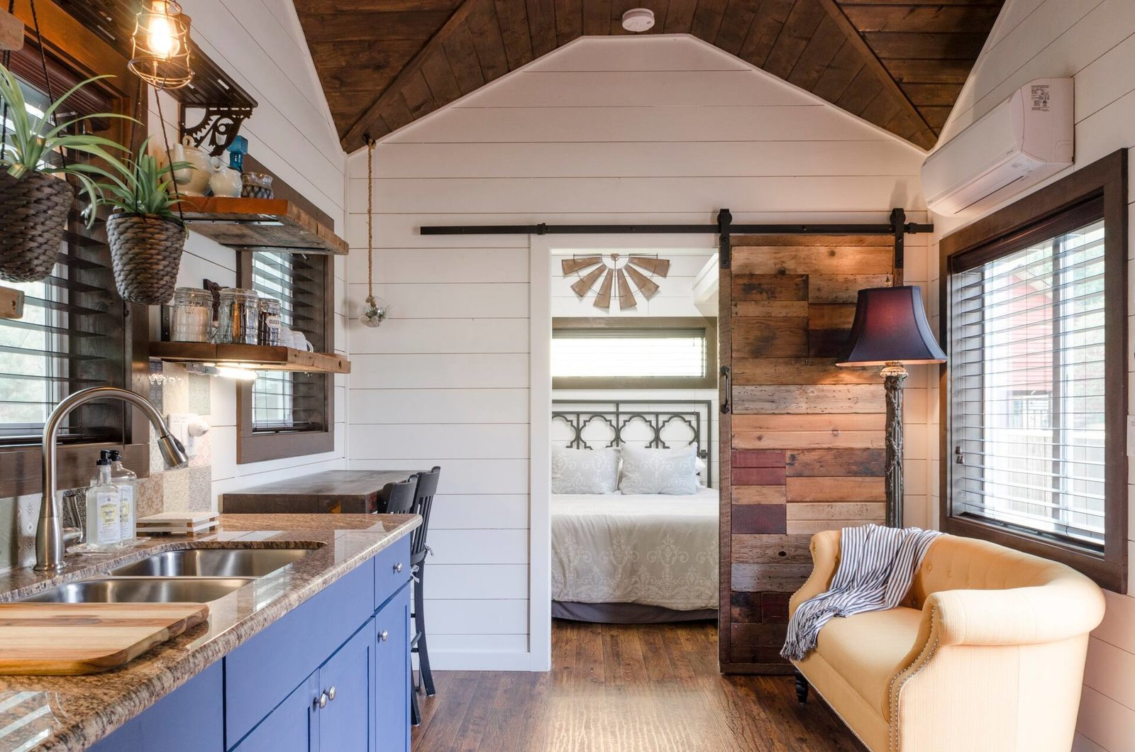 Just half a block away from Portland's boutique- and gallery-lined Alberta Arts District, this compact 300-square-foot abode with the rust cedar ceilings, shiplap walls, and stash of knick-knacks first welcomes visitors with a hand-painted bed post. The hosts built the home themselves, so look for thoughtful details like an artful petrified sink, Portland-made tiles, and the sliding barn door, shelves, and tables fashioned from salvaged wood. After dinner, relax at the fire pit table in the front courtyard.  Photo 2 of 18 in 17 Dreamy and Rentable Retreats for a Pacific Northwest Escape