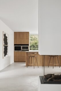 Another view of the kitchen reveals fittingly minimalist black-and-white artwork.