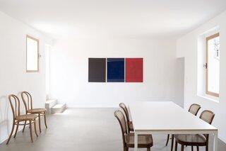 One side of the kitchen is graced by Ferdinando Maffii's triptych.