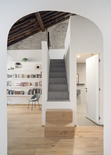 """The black slate staircase draws the eye upwards to the wooden ceiling, which took six months to restore. Dodi Moss """"treated it just like an intervention on a work of art, as a testimony of and investigation into the skill with which it had been created."""""""