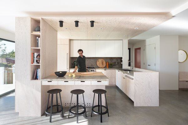 One of the owners is a chef, so the kitchen, featuring HAY Revolver bar stools,  naturally takes centerstage. Although it opens to the living room, the imposing butcher block ensures that cooks can be sealed away when maximum concentration is needed.