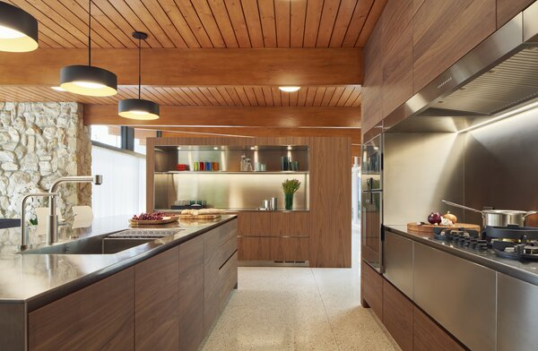 Sleek cabinetry, space-saving built-ins, and gleaming stainless steel define the kitchen.