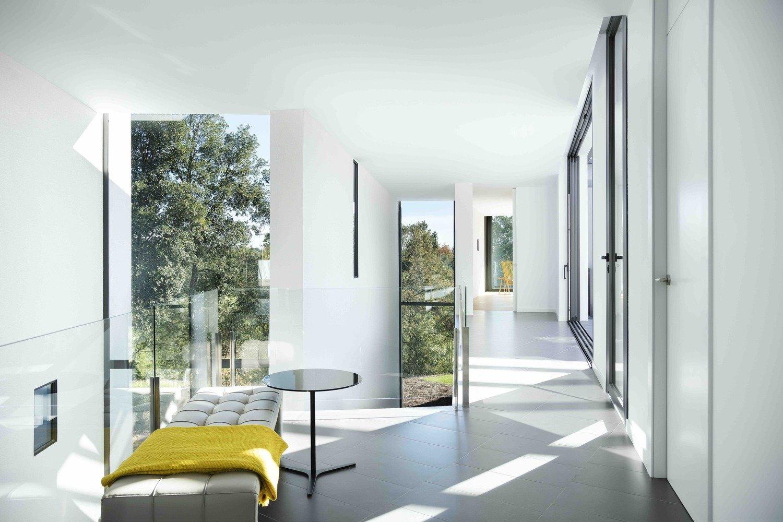 Hallway, Porcelain Tile Floor, Concrete Floor, Slate Floor, and Ceramic Tile Floor La Vinya, PGA Golf Resort | Studio RHE  La Vinya, PGA Golf Resort by Studio RHE