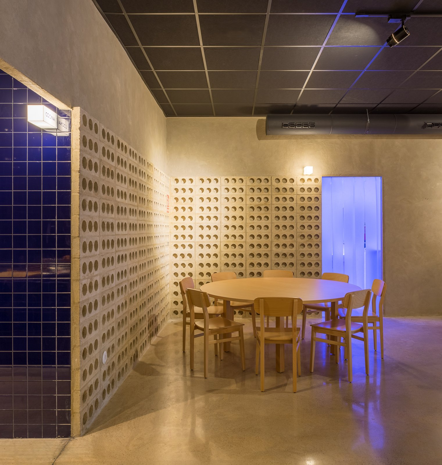 Dining Room, Chair, Table, Accent Lighting, Wall Lighting, Concrete Floor, and Track Lighting The bathroom lighting floods the room with blue.  IMOOD Restaurant