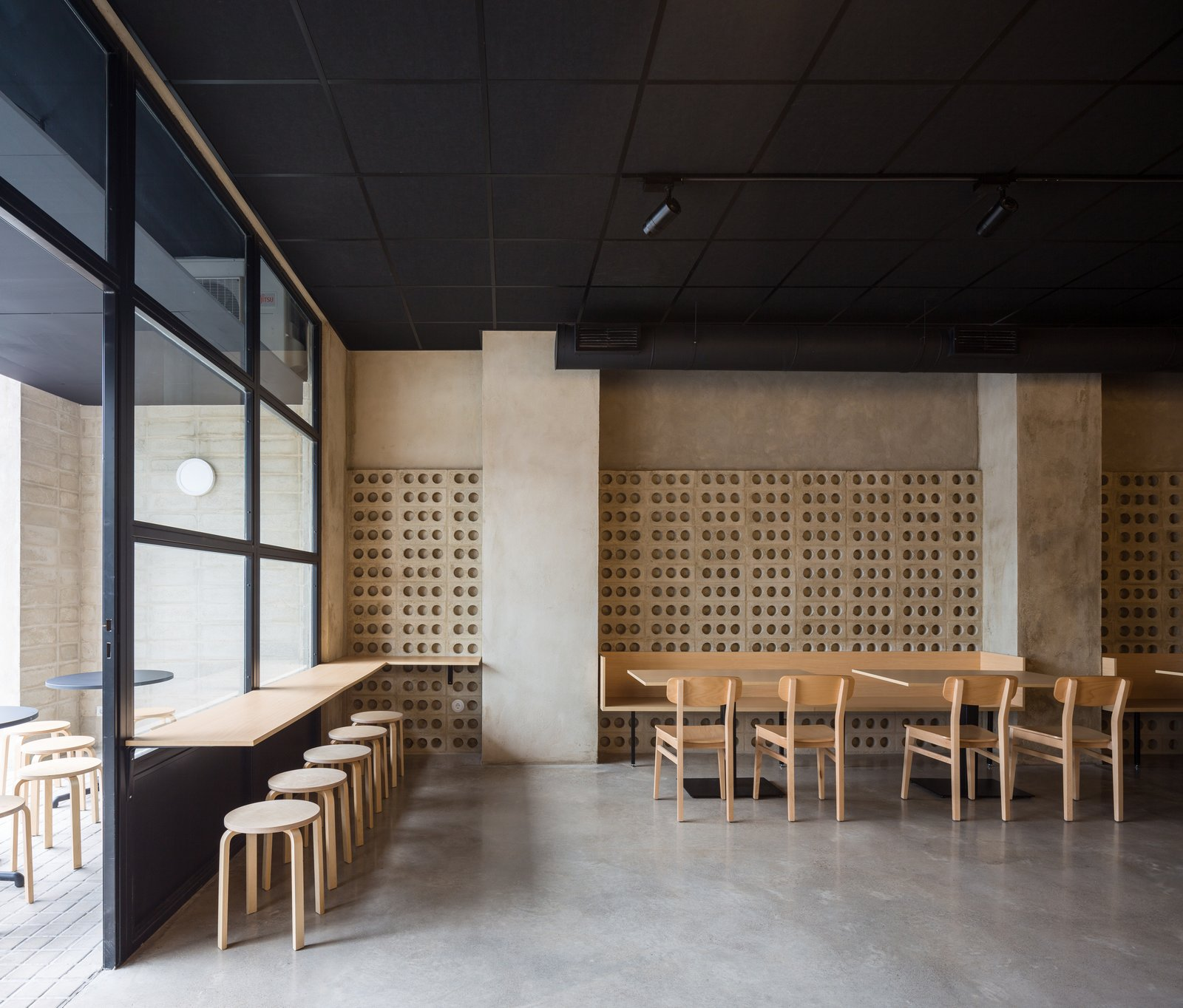 Dining Room, Concrete Floor, Table, Bench, Chair, Track Lighting, Wall Lighting, and Stools Casual dining area.  IMOOD Restaurant