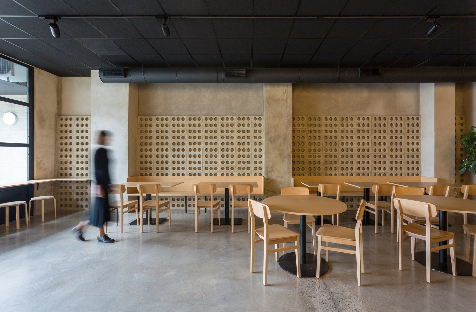 Dining Room, Wall Lighting, Concrete Floor, Bench, Stools, Track Lighting, Table, and Chair The wood stands out in a cement box.  IMOOD Restaurant