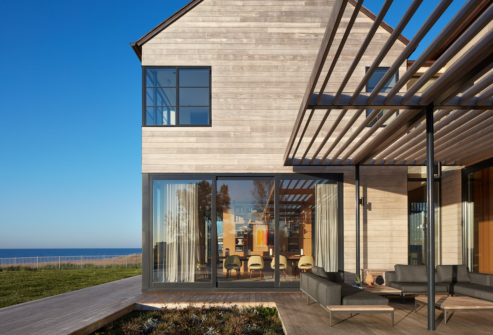 Exterior, Shed RoofLine, Beach House Building Type, House Building Type, and Wood Siding Material Looking North into the Dining Room  Best Photos from St Joseph Beachfront Home