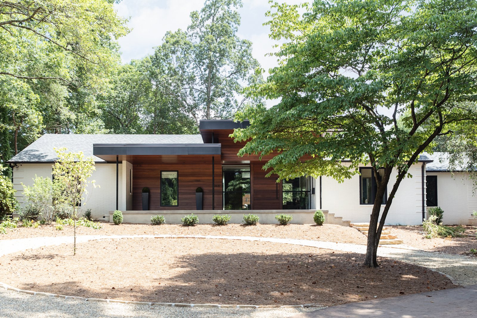 Exterior, Wood Siding Material, Metal Roof Material, Hipped RoofLine, House Building Type, and Mid-Century Building Type New, modern entry of residence (formerly a traditional, ranch home)  Guinn/Henderson Residence