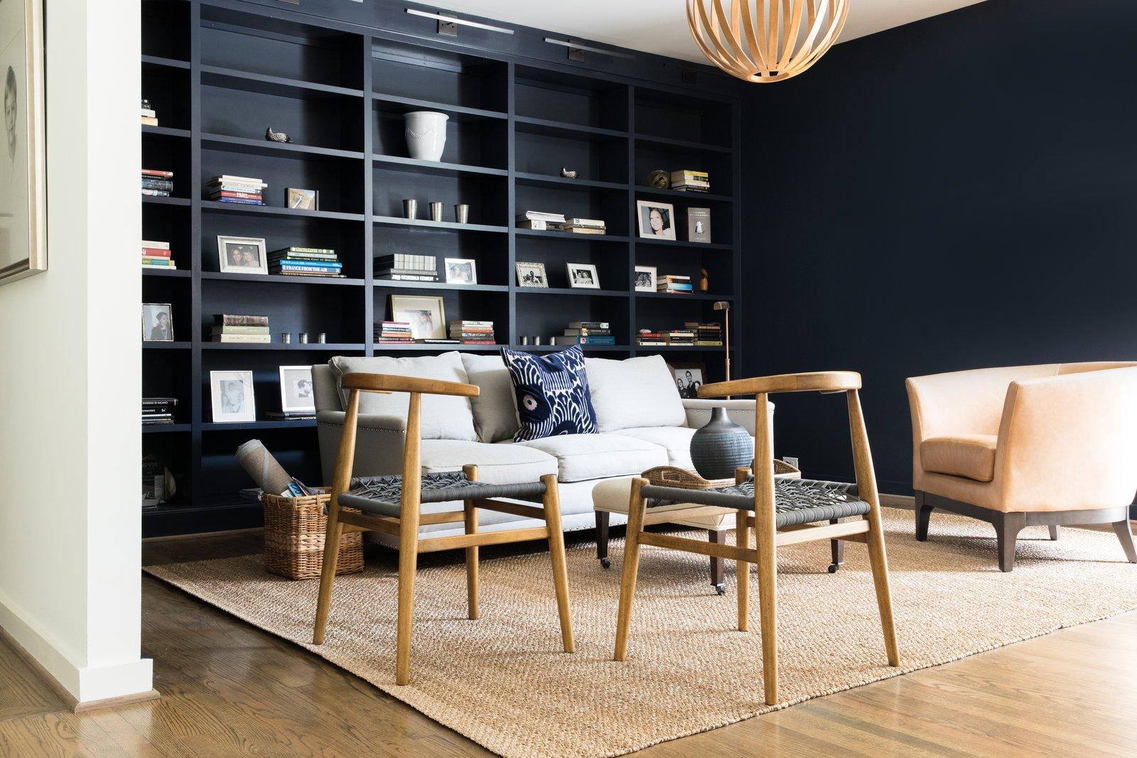 Office, Shelves, Medium Hardwood Floor, Bookcase, Study Room Type, and Lamps Study for relaxing and reading  Guinn/Henderson Residence