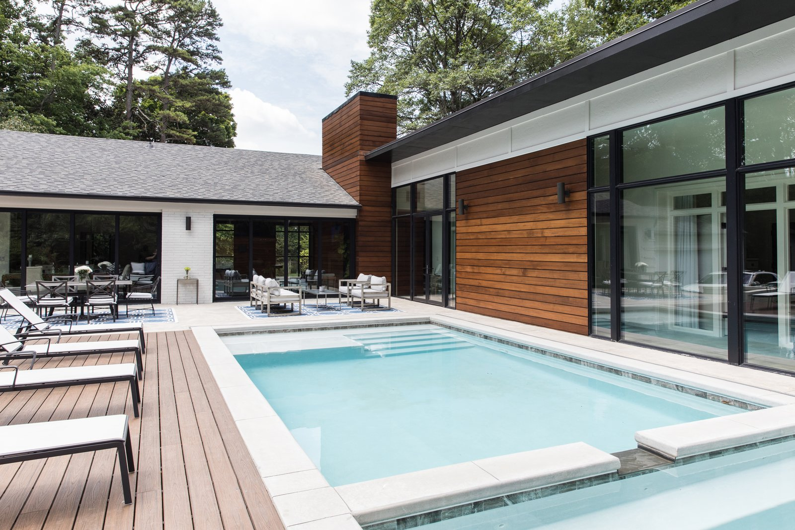 Exterior, House Building Type, Mid-Century Building Type, Hipped RoofLine, Wood Siding Material, and Shingles Roof Material Back terrace featuring a pool and spa  Guinn/Henderson Residence