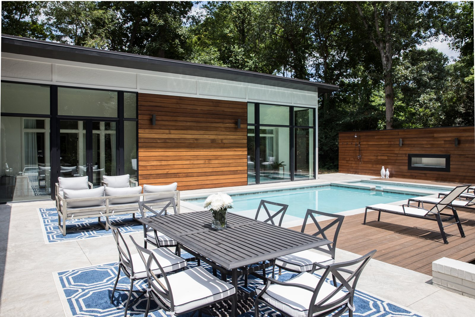 Outdoor, Swimming Pools, Tubs, Shower, Walkways, Shrubs, Landscape Lighting, Large Pools, Tubs, Shower, Wood Fences, Wall, Back Yard, Large Patio, Porch, Deck, Horizontal Fences, Wall, Decking Patio, Porch, Deck, Wood Patio, Porch, Deck, Post Lighting, Concrete Pools, Tubs, Shower, Concrete Patio, Porch, Deck, Hardscapes, and Trees Addition of two master suites as viewed from terrace  Guinn/Henderson Residence