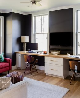 """The first floor has a separate home office were we flipped the exterior color palette by painting the walls black and the windows white,"" says Hawthorn Builders."