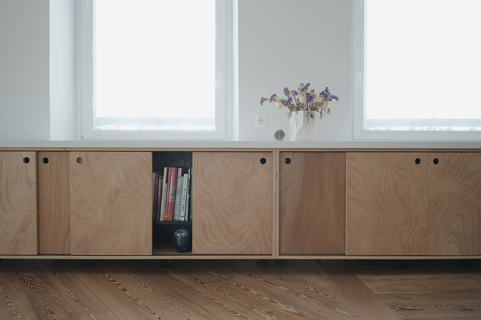 Living Room and Bookcase detail of custom made wooden furniture  Corner Apartment in Strasbourg, France by Dratler Duthoit