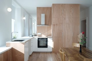 the kitchen is at the center of the living space