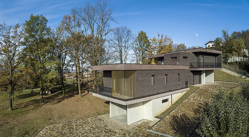 Exterior, Concrete Siding Material, Brick Siding Material, Metal Siding Material, House Building Type, and Flat RoofLine The volumes follow the natural topography of the site  Villa Rambo