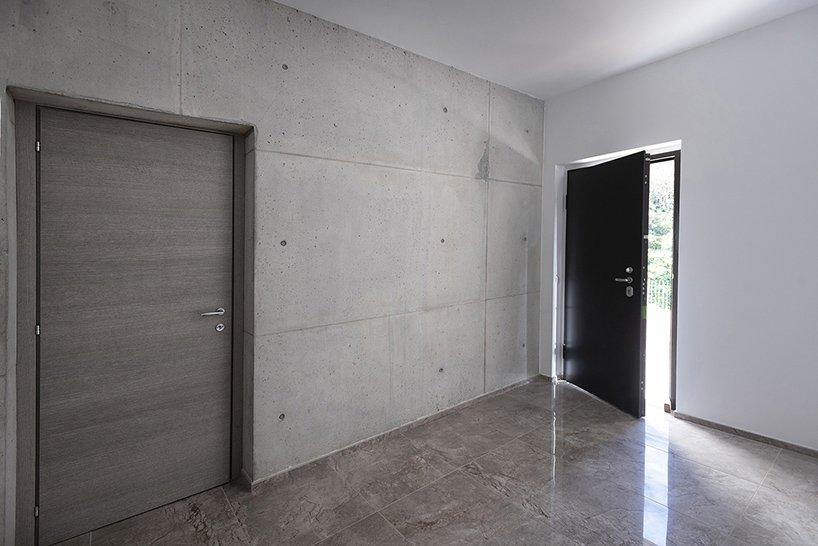 Hallway and Concrete Floor Light grey exposed concrete in the main entrance  Villa Rambo