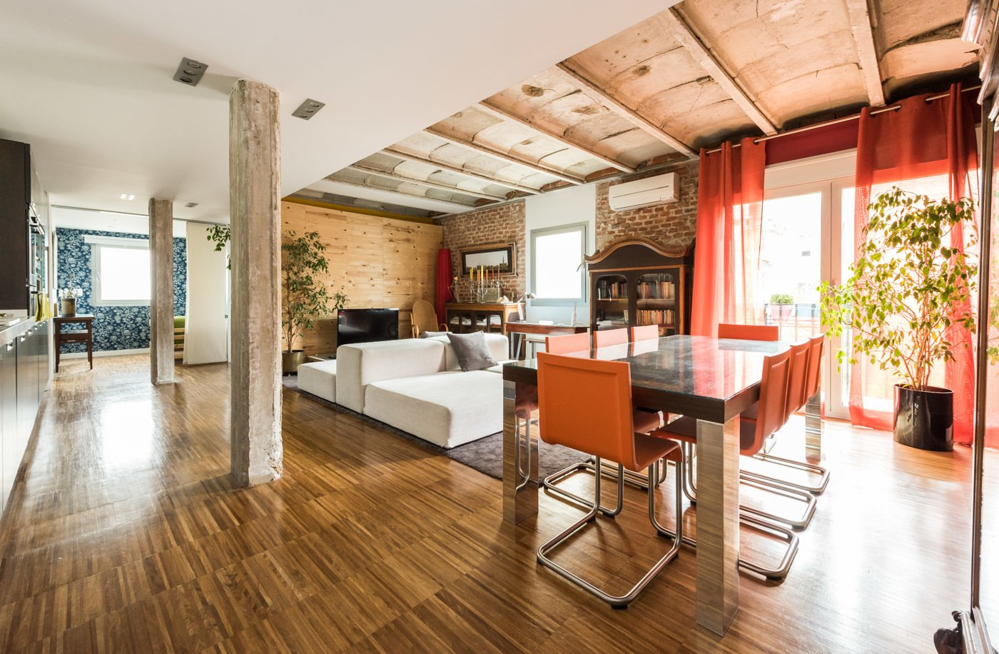 Living Room, Medium Hardwood Floor, Bench, Ceiling Lighting, Console Tables, Sofa, Chair, and Bookcase  The floor was made in iroko industrial parquet, with water varnish.  Echávarri house 100m2. Loft between gardens.