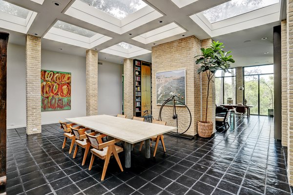 This midcentury marvel was the personal home of architect Preston Bolton. Recent renovations honor the home's history; the dining room features large skylights, brick pillars, and iconic midcentury furnishings.