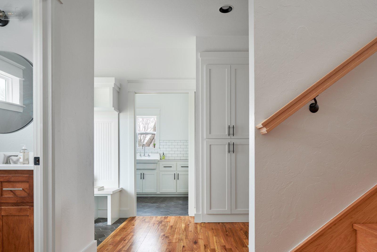 Hallway and Medium Hardwood Floor Hallway from Kitchen  OKC Farmhouse by Scharbach Workshop