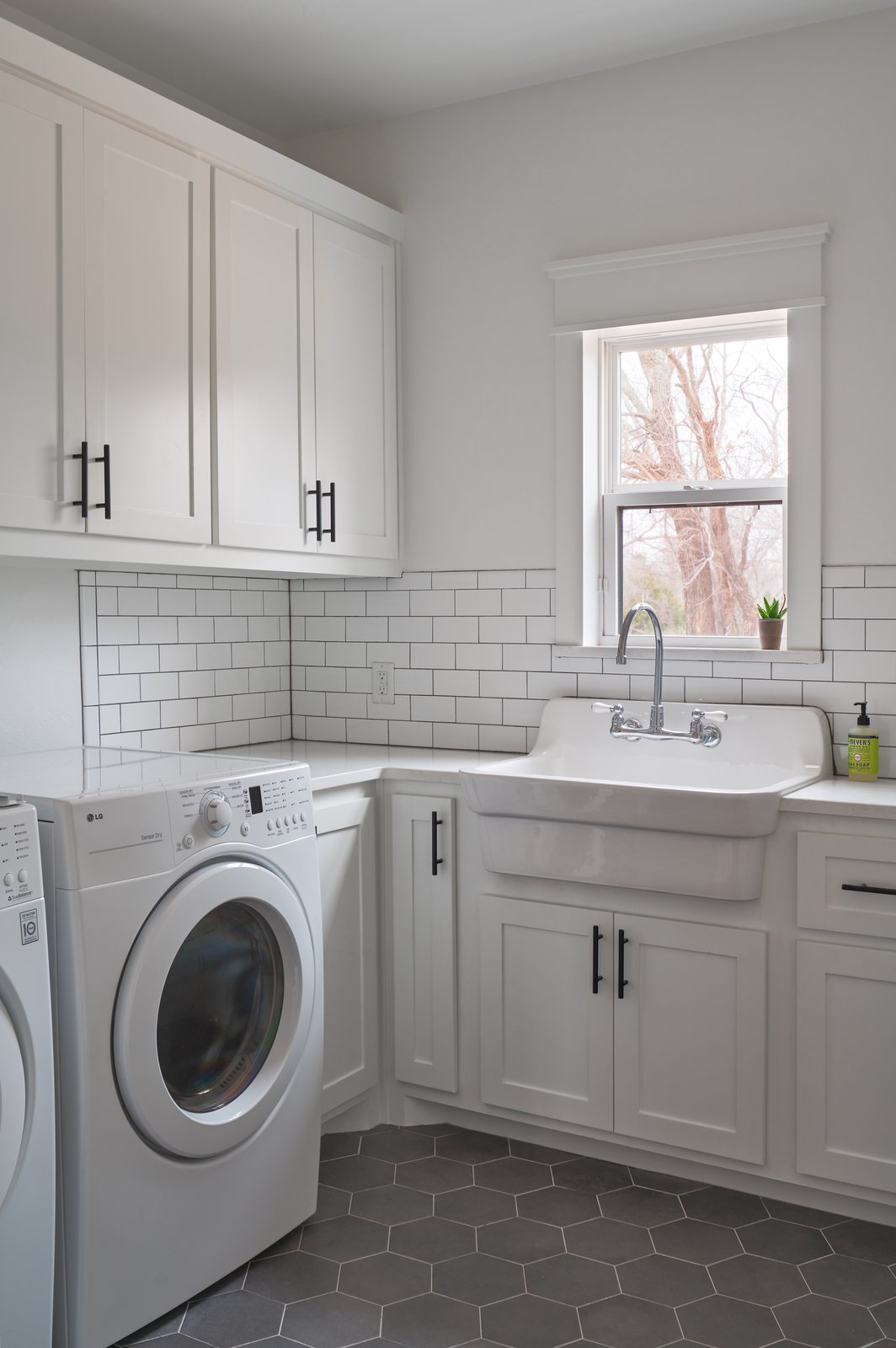 Laundry Room, Side-by-Side, White Cabinet, and Engineered Quartz Counter Laundry  OKC Farmhouse by Scharbach Workshop