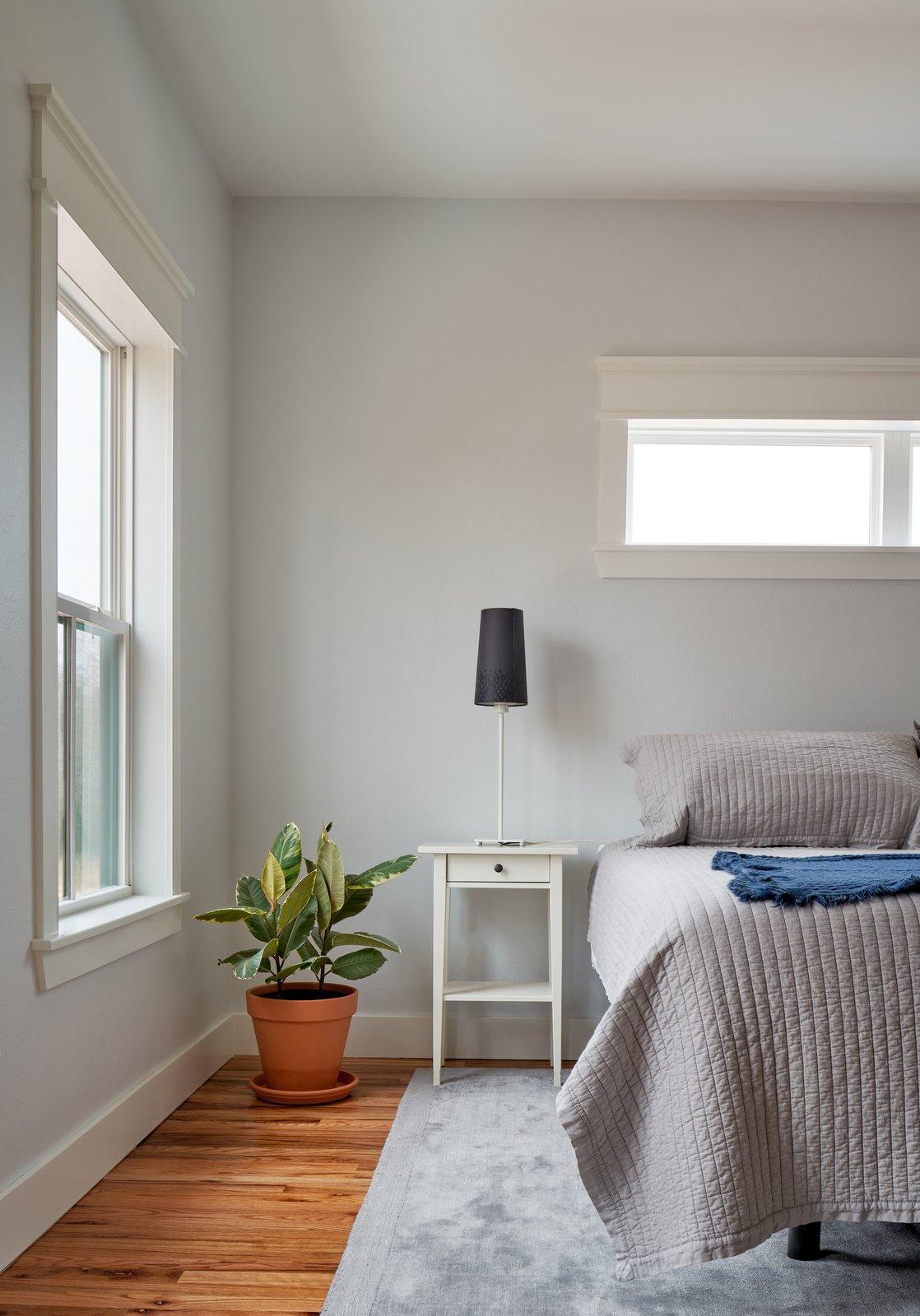 Bedroom, Bed, Medium Hardwood Floor, and Night Stands Master Bedroom  OKC Farmhouse by Scharbach Workshop