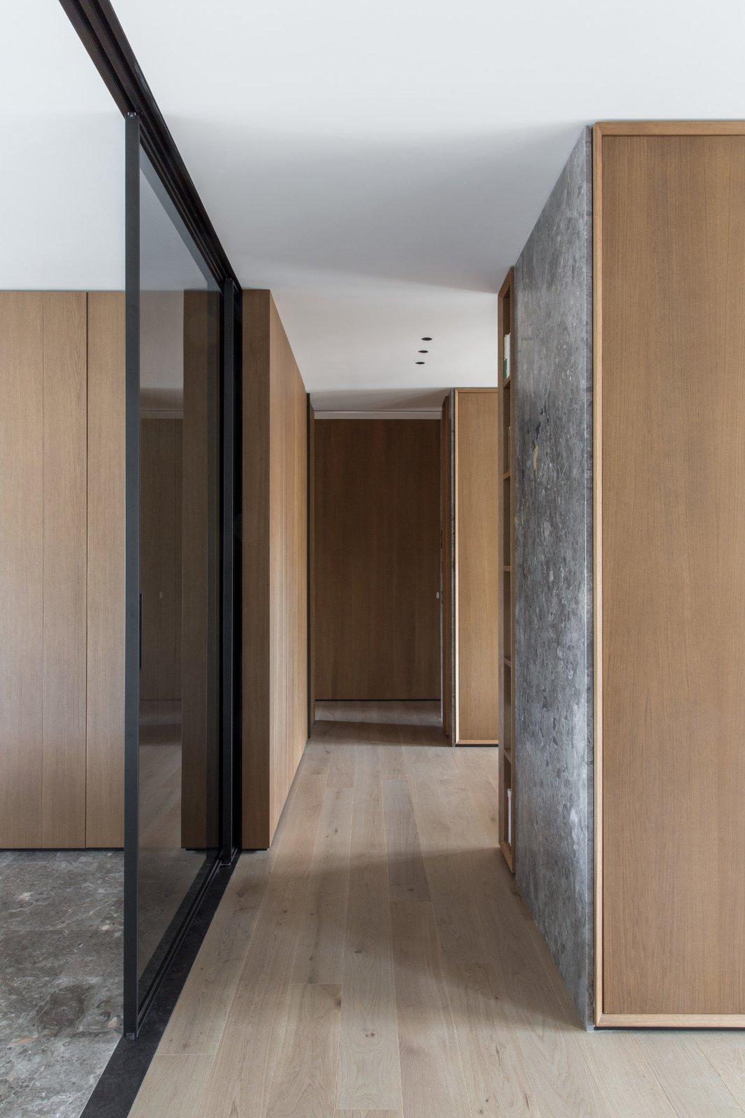 Hallway and Medium Hardwood Floor The smoked glass sliding door  House A326