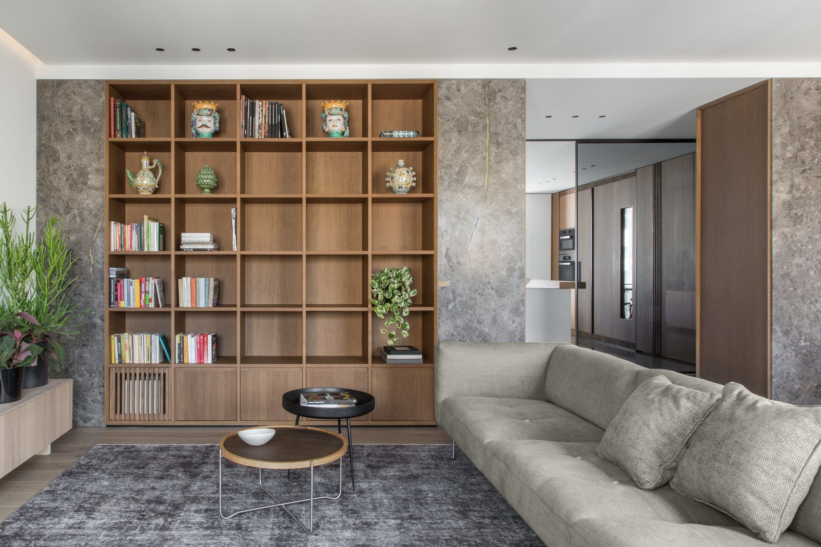 Living Room, Bookcase, Sofa, Coffee Tables, Ceiling Lighting, and Medium Hardwood Floor The custom made library  House A326