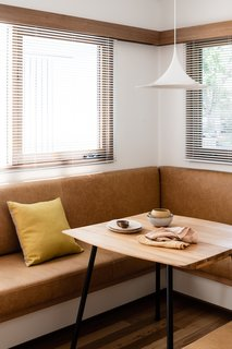 A cozy breakfast nook at the front of the house gets a glimmer of soft morning light.