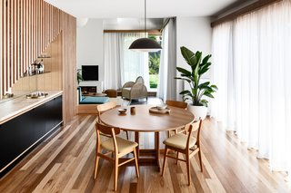 A compact dining room acts as a focal point of the home, with easy access to the living room and pool.