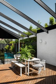 A sunny, California aesthetic shines brightly in the outdoor patio.